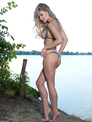 """The way Candice strips her sexy bikini outdoors and flaunts her gorgeous body, coupled by her sultry, seductive stare have a hypnotizing effect"