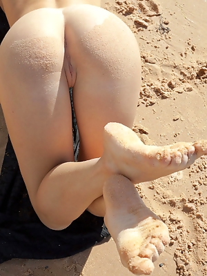 """Viola A's magnificent large breasts takes the center stage as this buxom blonde poses by the beach."""