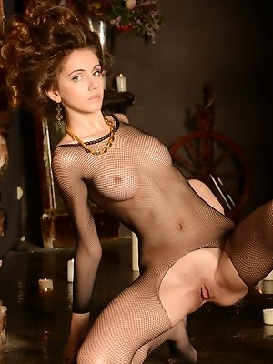 Garbed in full body fishnet lingerie, Sabrina G sensually exhibits her gorgeous body.