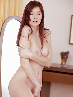 Stunning redhead Kattie Gold massages her magnificent tits and then moans as she pleasures her soft shaved creamy pussy